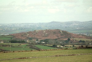 Trencrom Hill from Castle an Dinas. Carn Brea above Redruth is behind